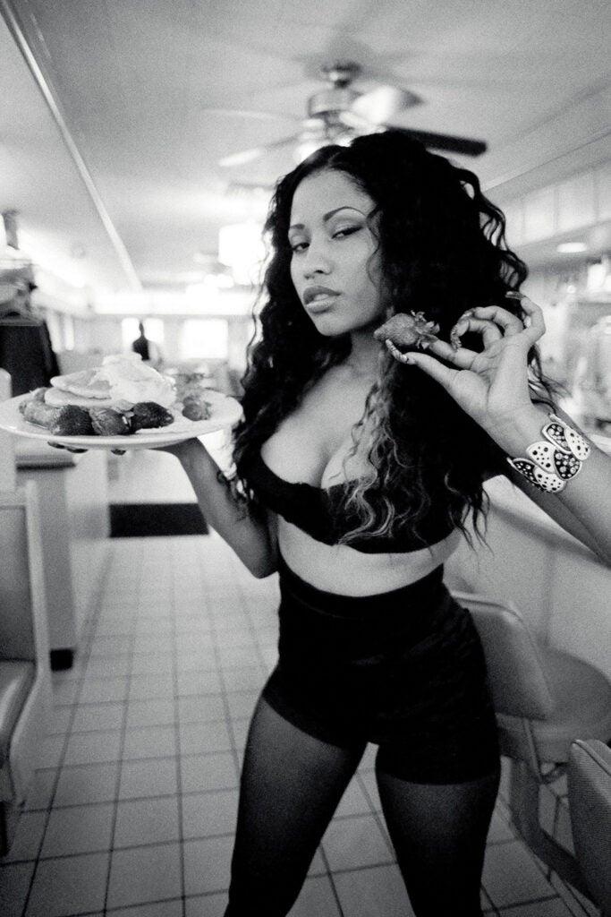 Nikki Minaj with a plate of breakfast food