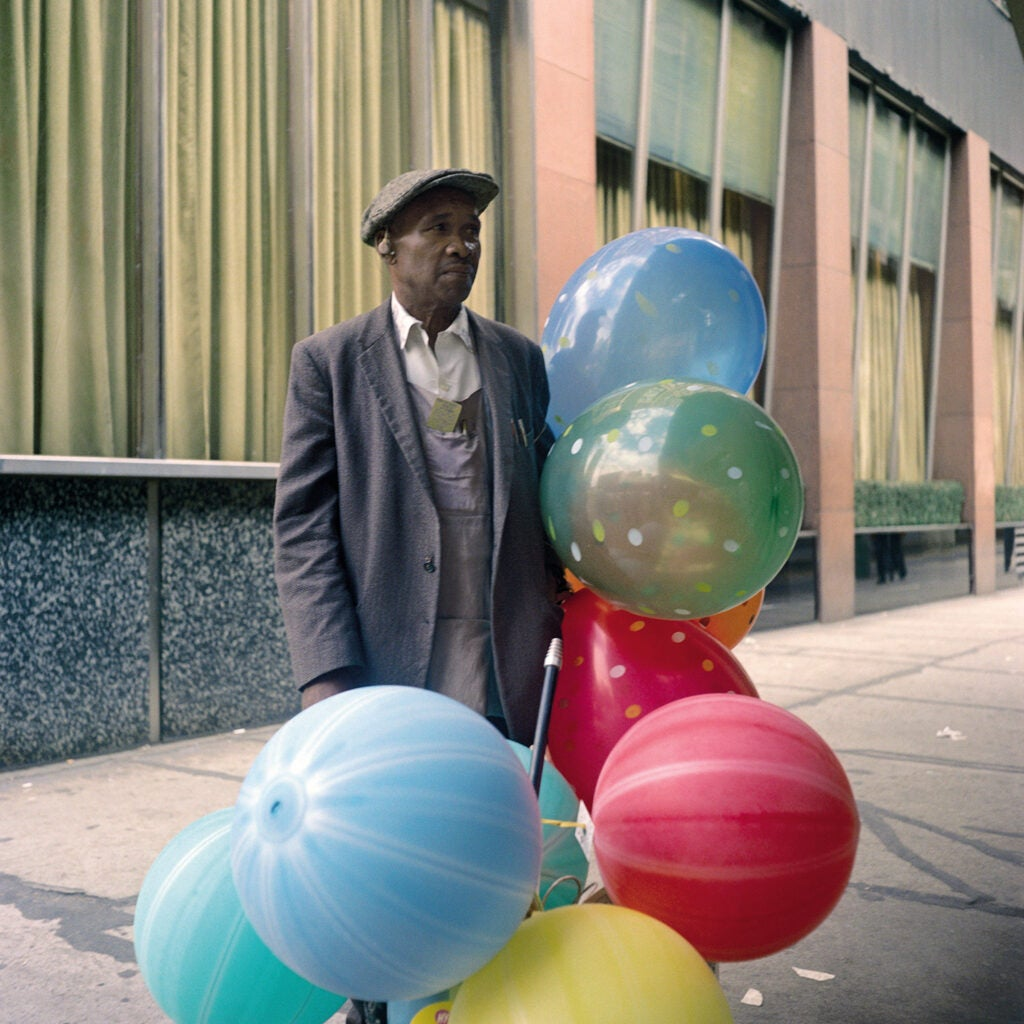 man with colorful balloons
