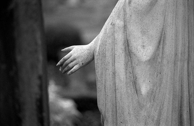 black and white statue hand