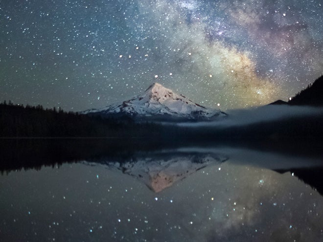 A star field reflected in the water
