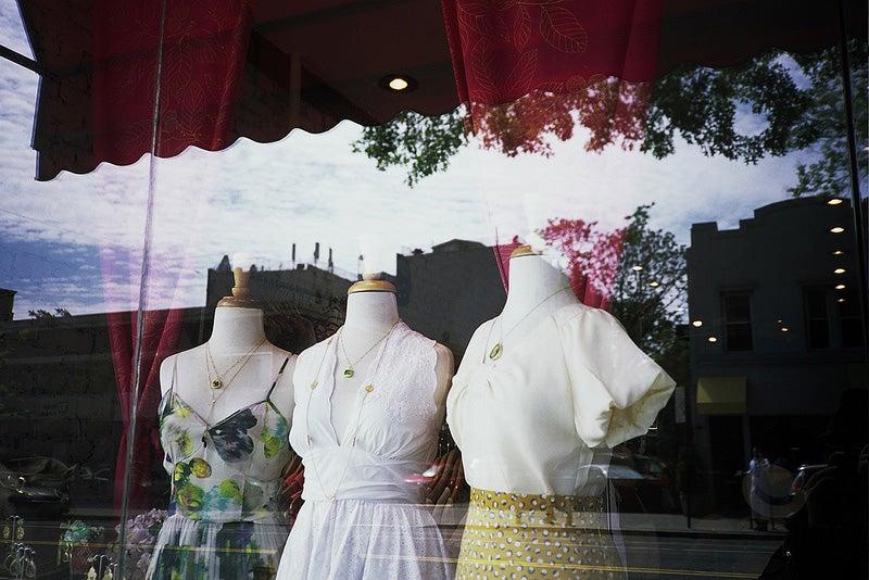 dresses on mannequins in a shop