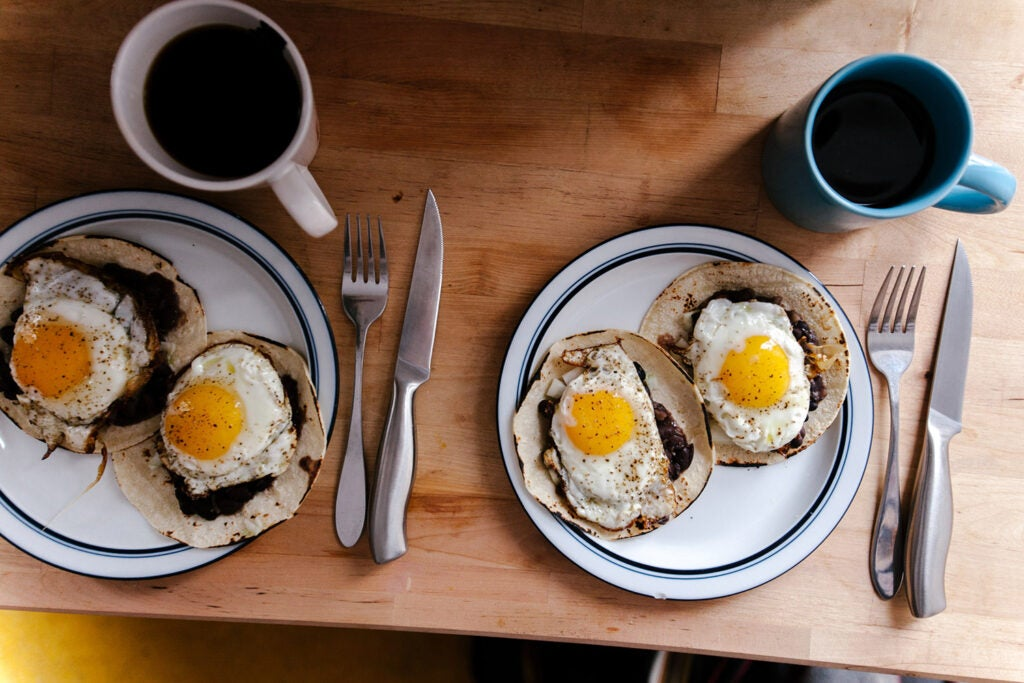 two plates of eggs and coffees