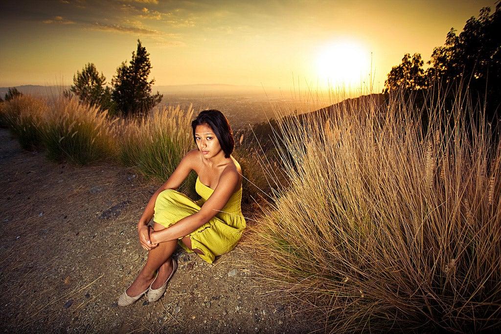 girl against a desert sunset