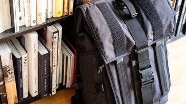 mission workshop backpack against bookshelf