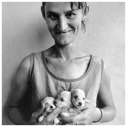 """Wife-of-abattoir-worker-holding-three-puppies-Ora"""