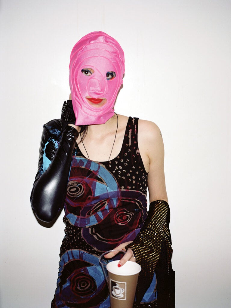 masked woman with coffee