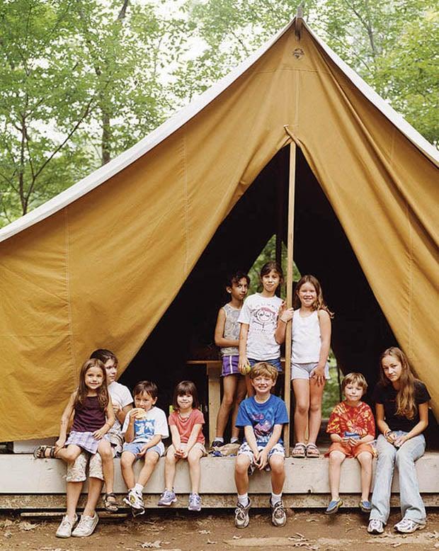 children posing in large tent