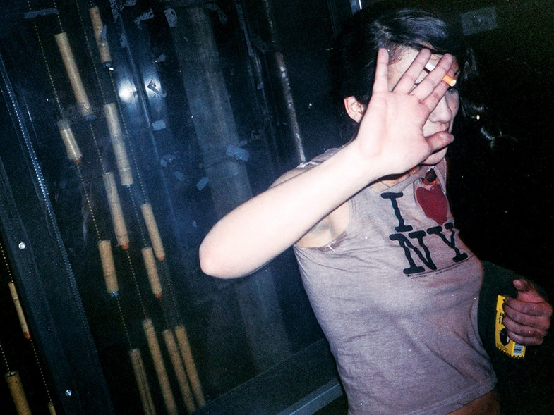New York girl hiding face