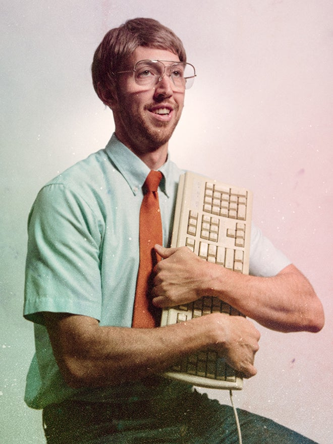 nerdy man with keyboard