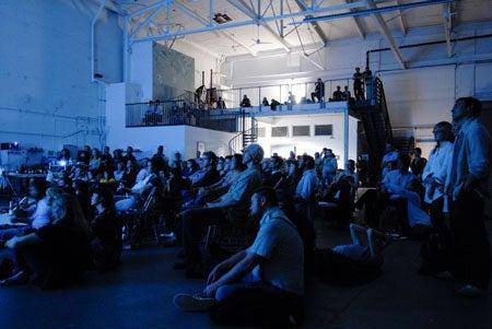 """""""Slideluck-Potshow-Attendees-watch-a-presentation"""""""