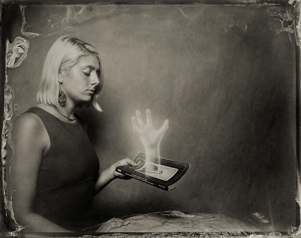 girl holding haunted book
