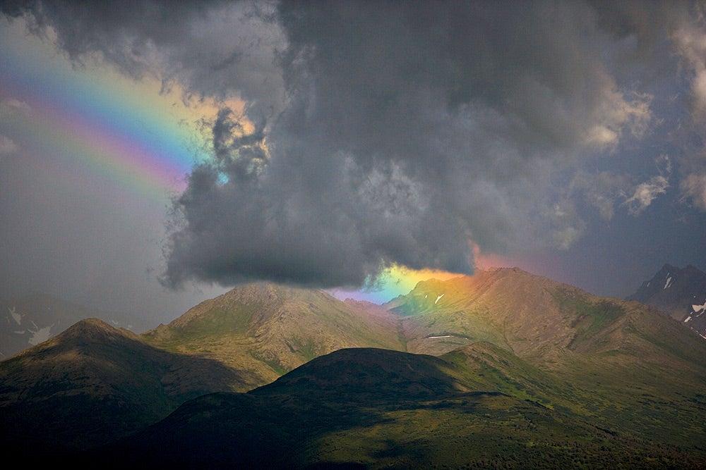 Rainbow among dark clouds in Katmai Alaska