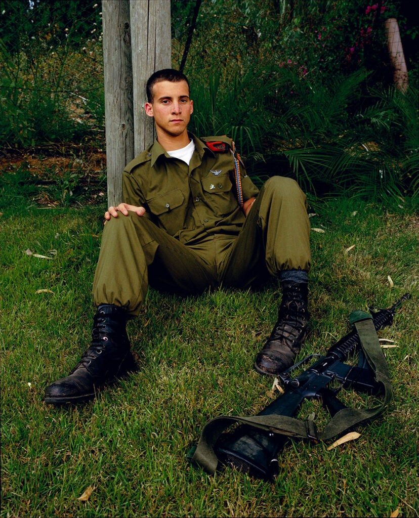 soldier sitting in back yard