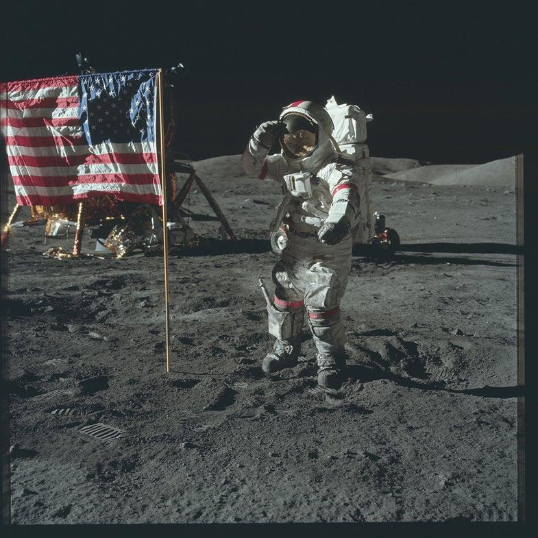 astronaut saluting flag on the moon