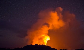This Time-Lapse Shows the Stars Over Molten Lava As It Enters the Ocean