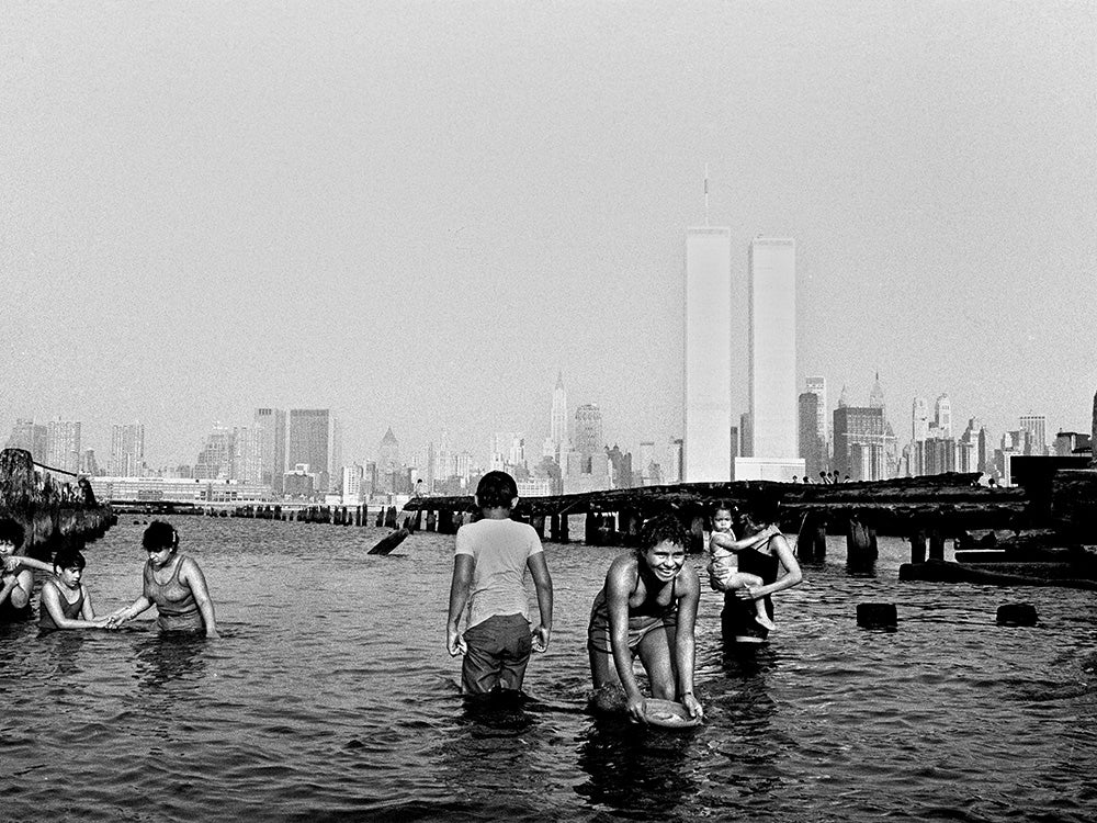 children playing in water near twin towers