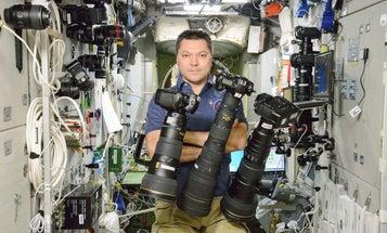 Photo: Russian Astronaut Floats in a Cloud of Fancy Nikon Camera Gear on the International Space Station