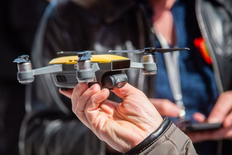 DJI Spark drone in hand