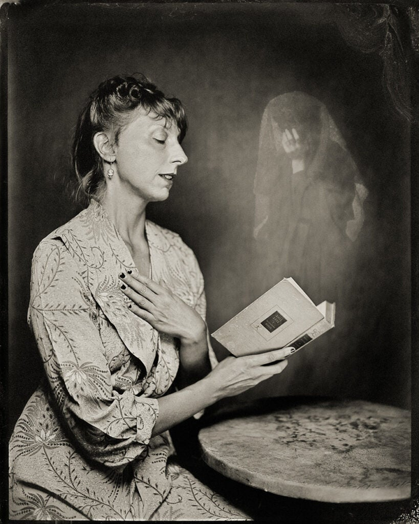 woman reading possessed book