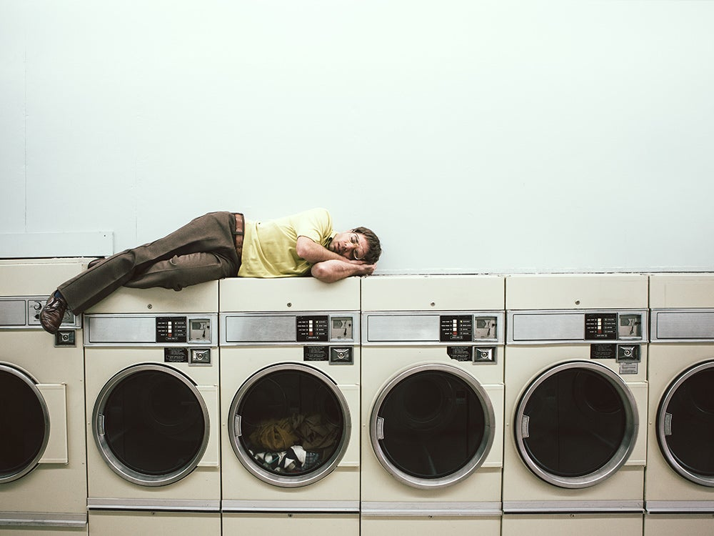 Man Sleeping at Laundromat