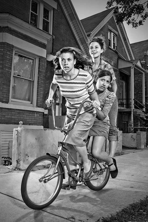 three girls riding one bike