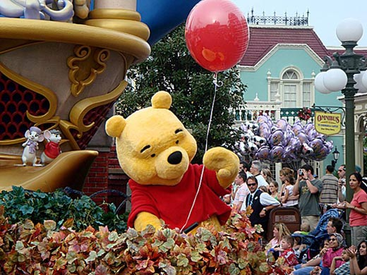"""""""Winnie-the-Pooh-waves-to-the-crowd-during-a-parade"""""""