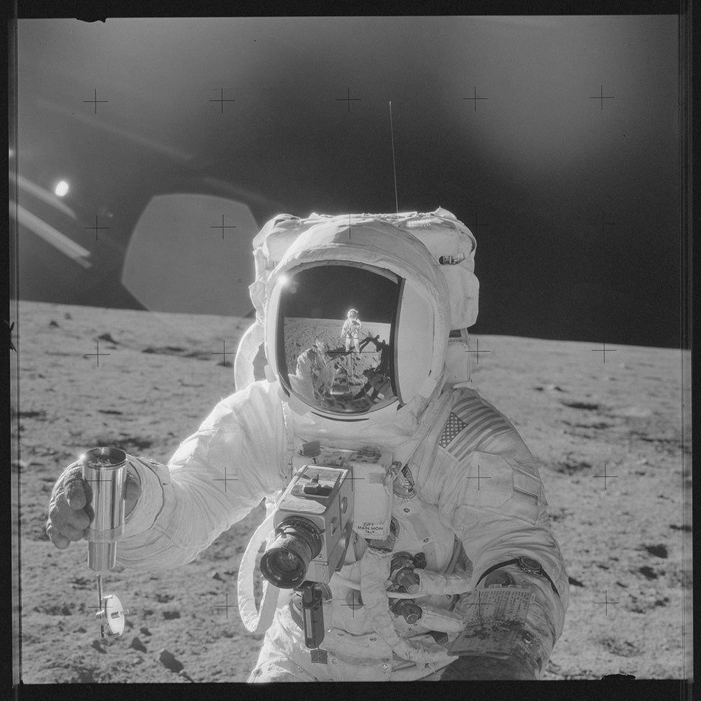 astronauts photographing each other