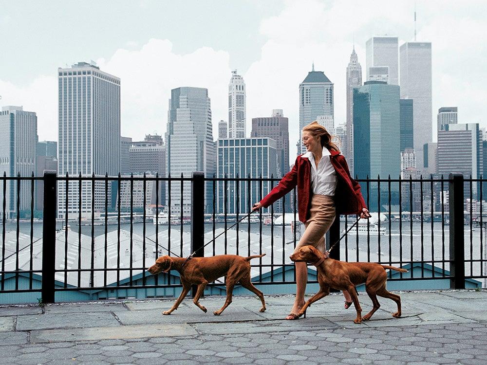 woman walking dog near world trade center