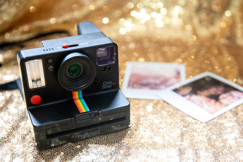 Polaroid OneStep+ with prints