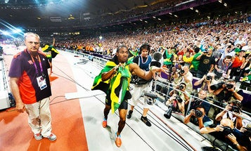 Usain Bolt Celebrates Another Gold Medal By Grabbing a Nikon D4 And Taking Picture