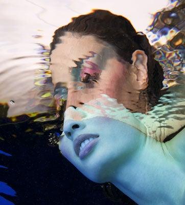 """Liquid-Light-A-model-s-half-submerged-head"""
