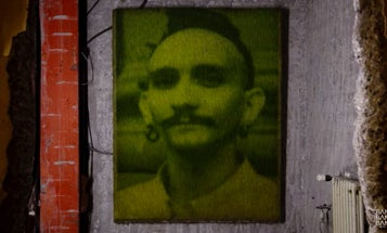 """Watch This: Artists Ackroyd & Harvey Use Projected Light To """"Print"""" Photos On Grass"""