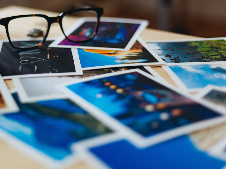 glasses on a stack of photos