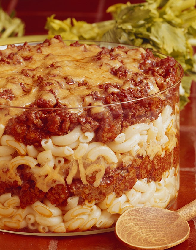 Macaroni pasta layered with meat in bowl