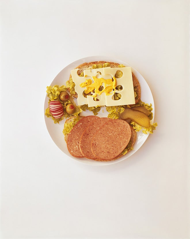 Plate of breakfast with sausage cheese and olive