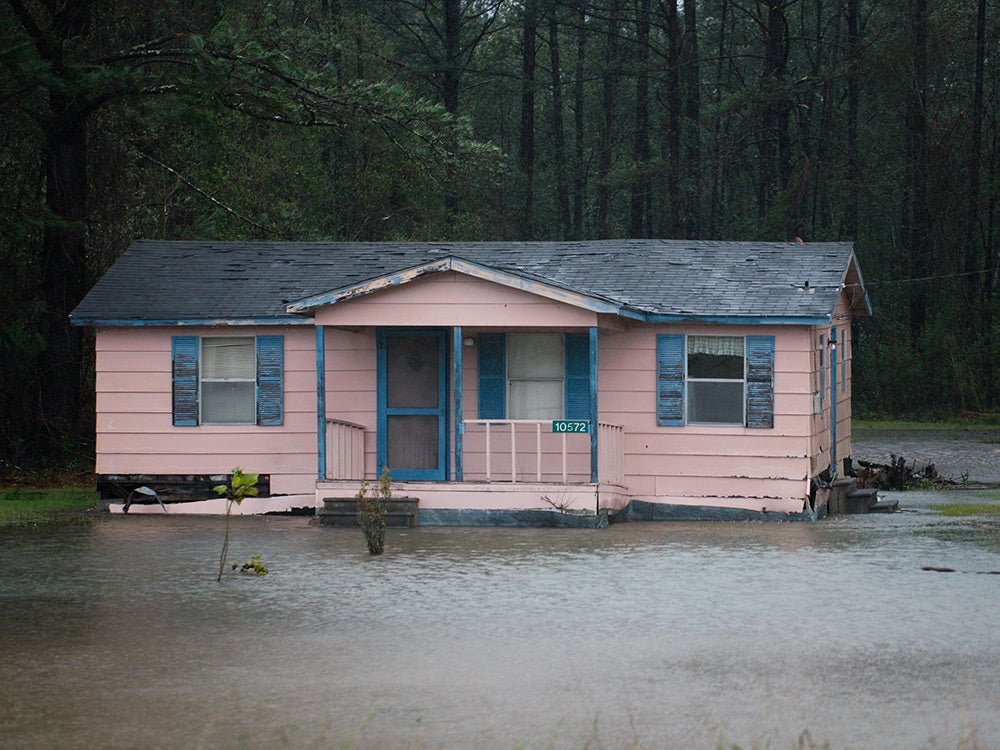 home sitting in flood water