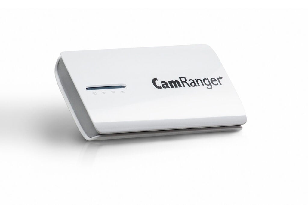 [Camranger](http://camranger.com/): This wirelessly transmitted a live view from the camera to an iPad for real-time image evaluation. $300, street.
