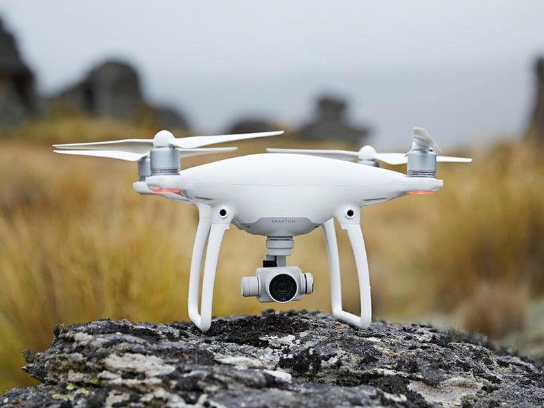 White DJI phantom drone on a rock