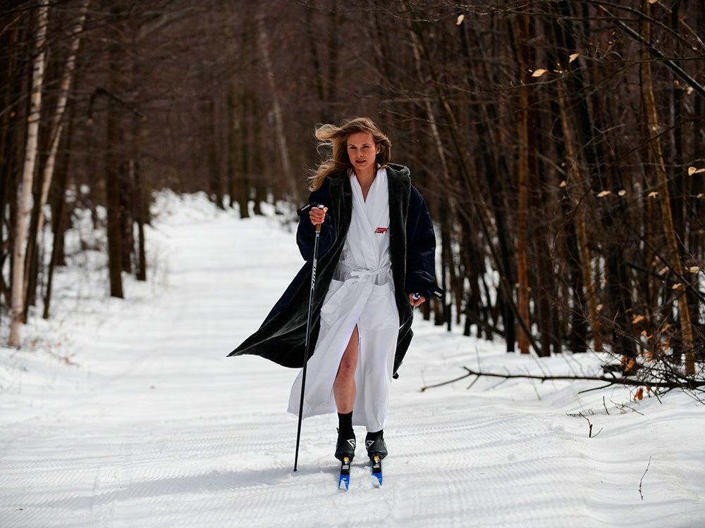 athlete in robe skiing through snow
