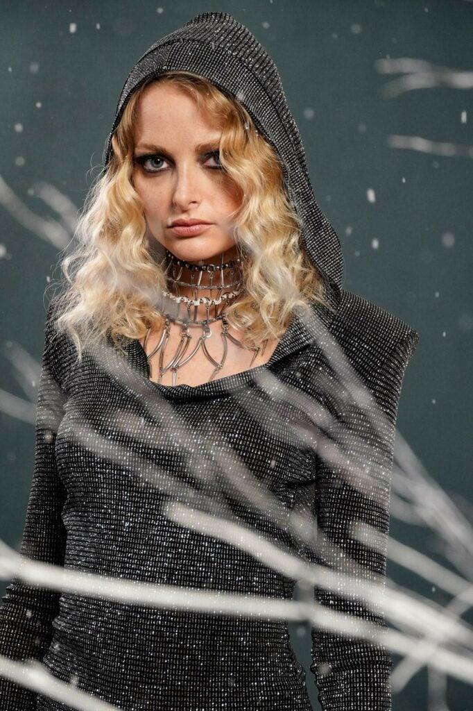 model in dark clothing