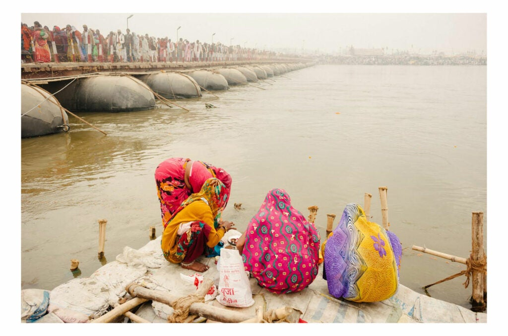 Women crouching on the docks