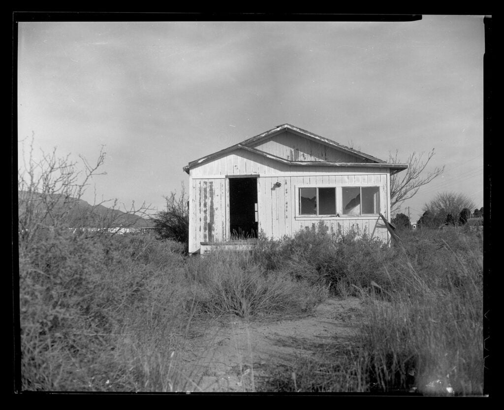 black and white house in the country