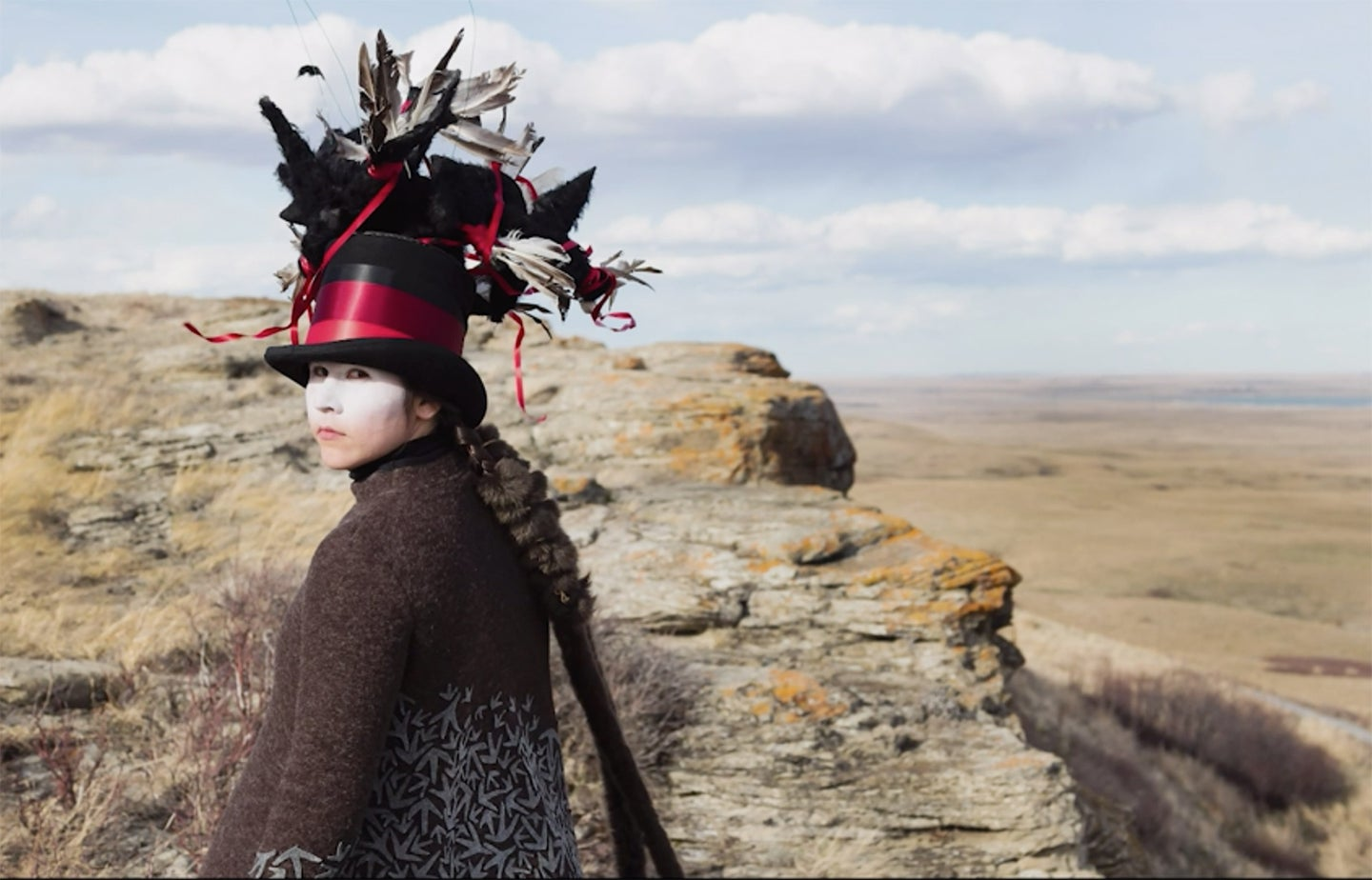 woman in a feathered tophat