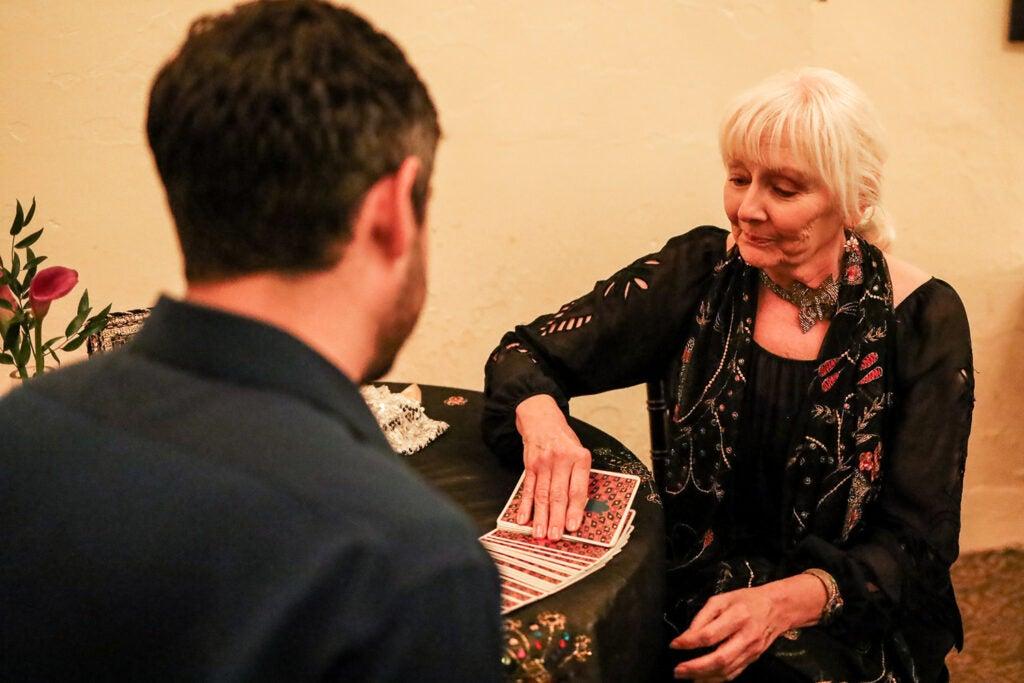 woman reading tarot cards