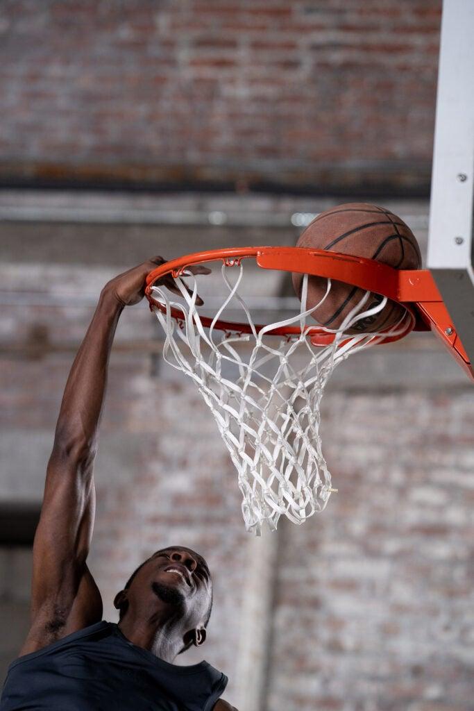 basketball playing dunking ball
