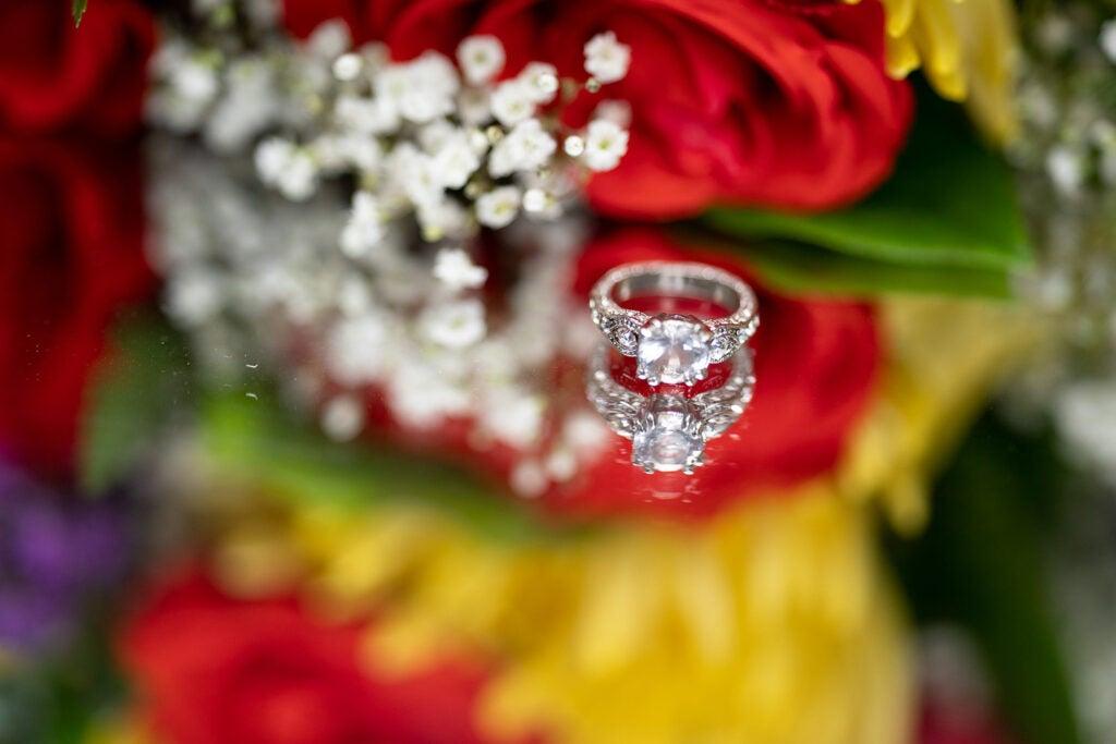 wedding ring among flowers