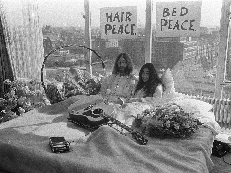 John Lennon and Yoko Ono in bed