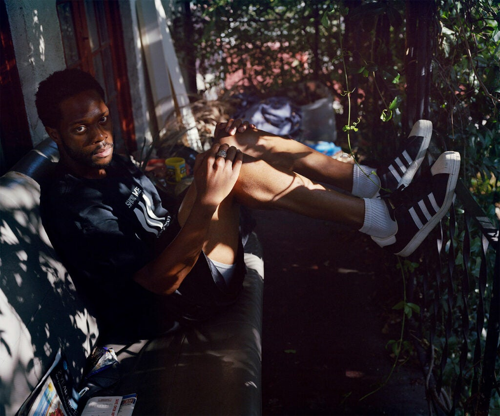 man relaxing on porch swing