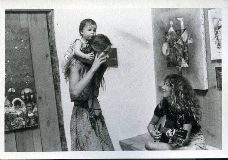 woman with baby on shoulders