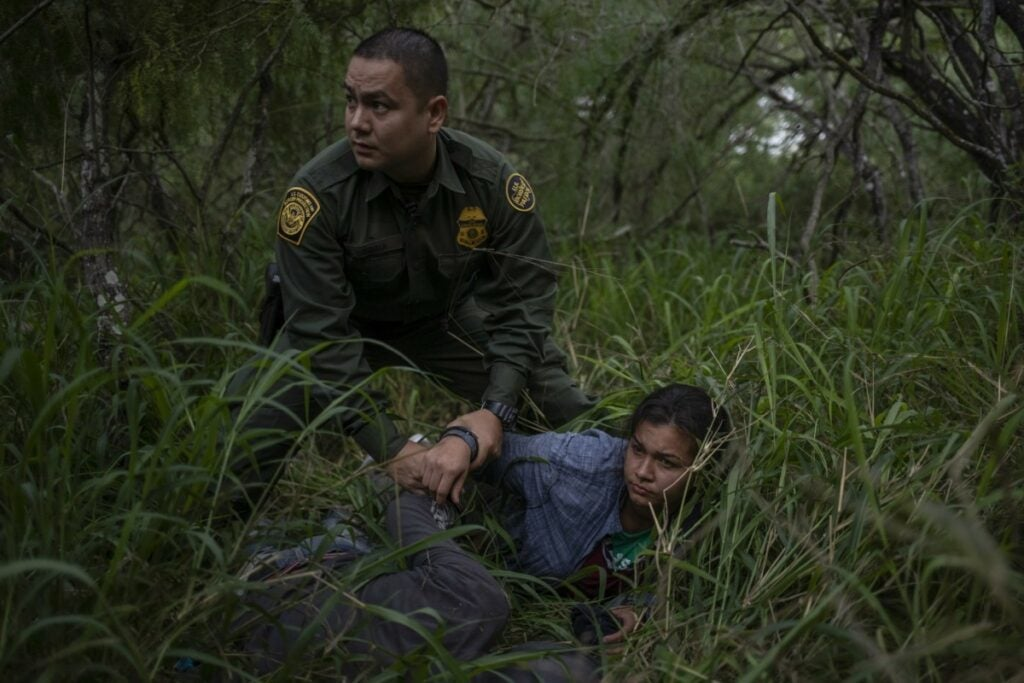 Young migrant girl being detained